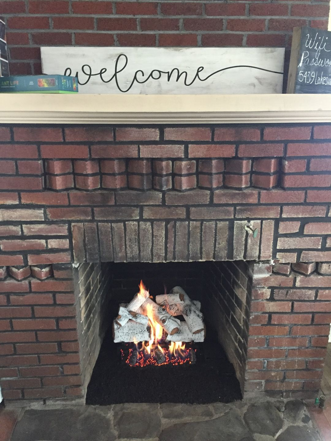 installed aspen timbers, vented, natural gas log set, into wood burning fireplace