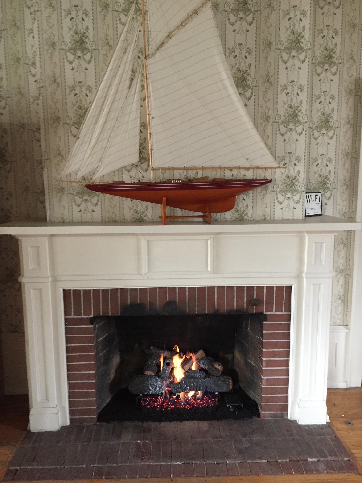 cross timbers log set into wood burning fireplace