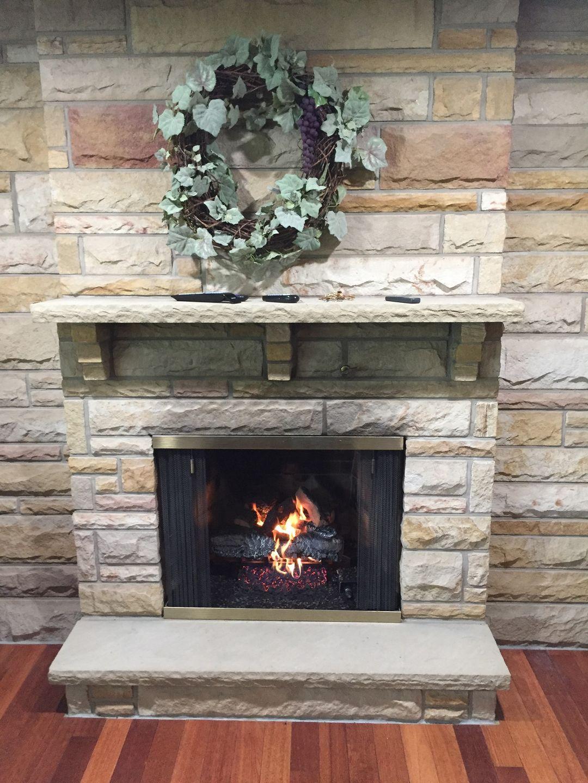 Hargrove Log Set into wood burning fireplace.